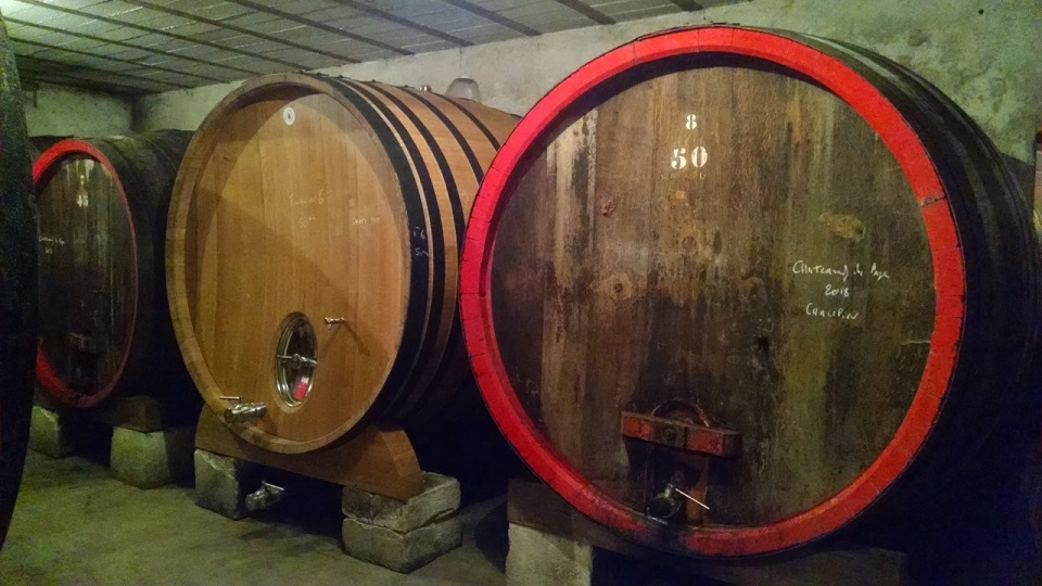 Large  oval wooden foudres have long been the vessel of choice for raising grenache in ch%c3%a2teauneuf du pape copy